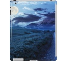 gravel road to high mountains at night iPad Case/Skin