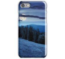 tree on hillside path through  meadowon hillside at night iPhone Case/Skin