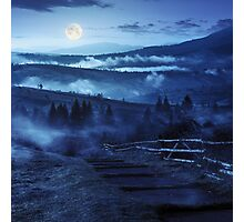 steps down to village in foggy mountains at night Photographic Print