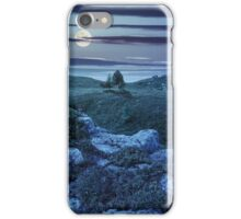 trees on hillside among huge boulders at night iPhone Case/Skin