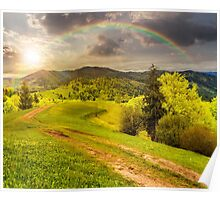 road on hillside meadow in mountain at sunset Poster