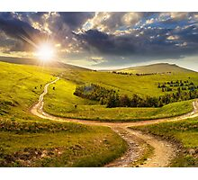cross road on hillside meadow in mountain at sunrise at sunset Photographic Print