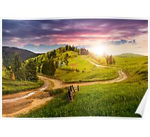 cross road on hillside meadow in mountain at sunset Poster