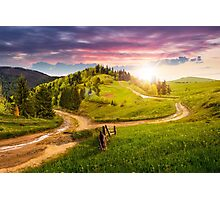 cross road on hillside meadow in mountain at sunset Photographic Print