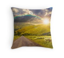 abandoned road through meadows in mountain at sunset Throw Pillow