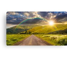 abandoned road through meadows in mountain at sunset Canvas Print