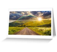 abandoned road through meadows in mountain at sunset Greeting Card