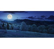 fence on hillside meadow in mountain at night Photographic Print