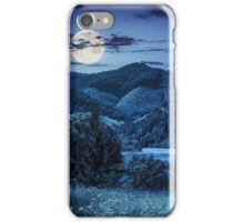 pine trees near meadow in mountains at night iPhone Case/Skin