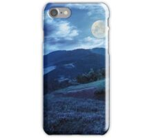 flowers on hillside meadow in mountain at night iPhone Case/Skin