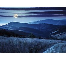 path on hillside meadow in mountain at night Photographic Print