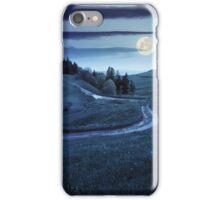 cross road on hillside meadow in mountain at night iPhone Case/Skin
