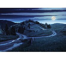 cross road on hillside meadow in mountain at night Photographic Print