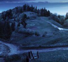 cross road on hillside meadow in mountain at night Sticker