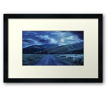 abandoned road through meadows in mountain at night Framed Print
