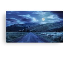 abandoned road through meadows in mountain at night Canvas Print