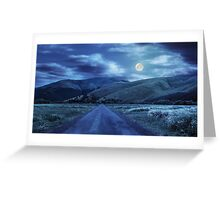 abandoned road through meadows in mountain at night Greeting Card