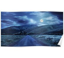 abandoned road through meadows in mountain at night Poster