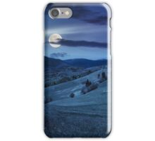 fence on hillside meadow in mountain at night iPhone Case/Skin