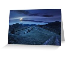 fence on hillside meadow in mountain at night Greeting Card
