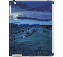 fence on hillside meadow in mountain at night iPad Case/Skin