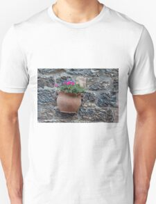 Pot of flowers on a stone wall Unisex T-Shirt