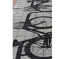 Shadows of bicycles on the asphalt Photographic Print