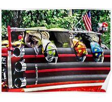 Three Fire Helmets on Fire Truck Poster