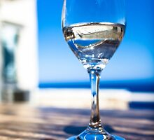 Glass on table by chrisdot