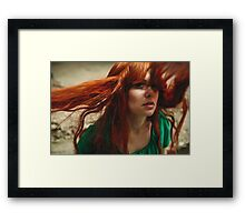 Beautiful ginger girl with deep green eyes and flying hair Framed Print