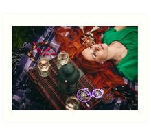 Beautiful red hair woman lying on plaid in grass Art Print