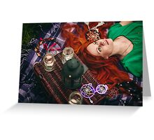 Beautiful red hair woman lying on plaid in grass Greeting Card