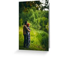 Young happy couple standing near water in green forest Greeting Card