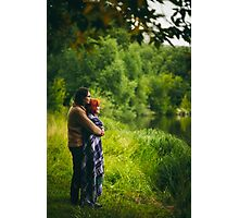 Young happy couple standing near water in green forest Photographic Print