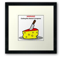 Cutting the cheese Framed Print