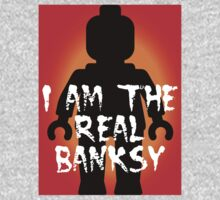 """Black Minifig with """"I am the Real Banksy"""" slogan, Customize My Minifig Baby Tee"""
