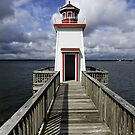 Land of the Lakes lighthouse by jammingene