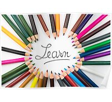 Colouring pencils in circle arrangement with message Learn Poster