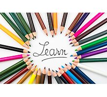 Colouring pencils in circle arrangement with message Learn Photographic Print