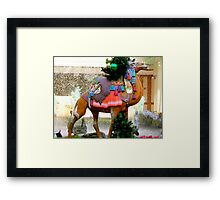 A Carousel Camel Decorated for Christmas Framed Print