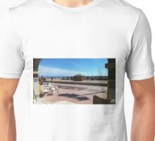 View of the beach from your table. Unisex T-Shirt