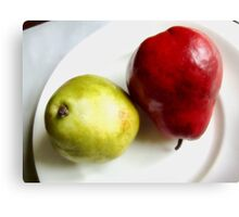 Red and Green Pears on a White Plate Canvas Print