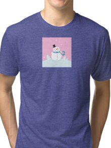 Christmas snowman on pink background. Cute snowman in christmas snowy nature. Vector cartoon illustration. Tri-blend T-Shirt