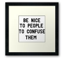 Be nice to people to confuse them Framed Print