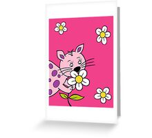 Cat smelling flowers Greeting Card