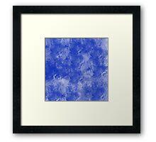 Blue paint splattered on canvas Framed Print