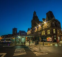 Newport Bus station at night  by Rob Hawkins
