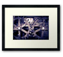 Cogs turning Framed Print