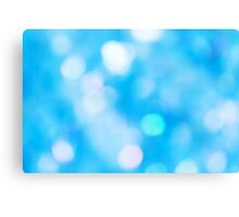 Blue defocused background with bokeh lights Canvas Print