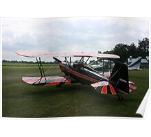 red and black biplane Poster